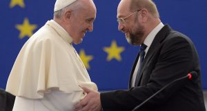"Pope Francis (L) is greeted by Martin Schulz, President of the European Parliament, before delivering a speech at the European Parliament, on November 25, 2014, during a short visit at the European Parliament and the Council of Europe in Strasbourg, eastern France. Pope Francis began a lightning visit to European institutions in Strasbourg where he was expected to call for a ""tired"" Europe hit by economic crises and surging nationalism to reclaim a leadership role."