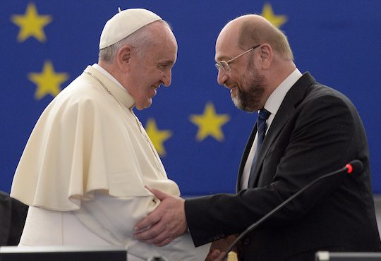 """Pope Francis (L) is greeted by Martin Schulz, President of the European Parliament, before delivering a speech at the European Parliament, on November 25, 2014, during a short visit at the European Parliament and the Council of Europe in Strasbourg, eastern France. Pope Francis began a lightning visit to European institutions in Strasbourg where he was expected to call for a """"tired"""" Europe hit by economic crises and surging nationalism to reclaim a leadership role."""